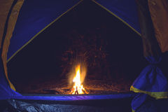 Bonfire and camping tent Stock Photo