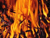 Bonfire close up. With flames, charred wood and ash stock photos