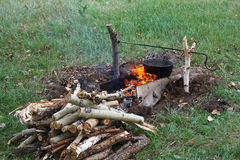 Bonfire. Cooking dinner in field conditions at the bonfire royalty free stock images
