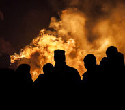Bonfire Crowd. A gathering of people silhouetted against a burning bonfire on November the 5th Royalty Free Stock Images