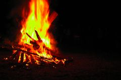 Bonfire on a dark background. Beautiful fire flames with copy space on black. Burning wood at night. Campfire at touristic camp. Bonfire on a dark background stock images