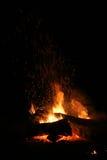 Bonfire on a dark background on wood burning Royalty Free Stock Photography