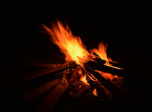 Bonfire flame with red charcoals on black background Royalty Free Stock Photography
