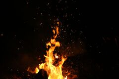 Bonfire flames and hot sparks  Stock Photos