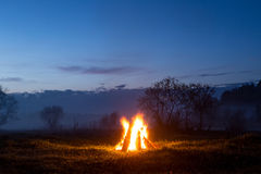 The bonfire flares up and goes out. The night is coming Stock Image