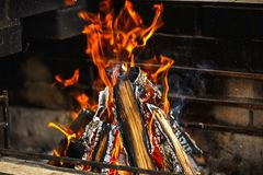 The bonfire in the grill. The fire in the grill close-up. bonfire in the fireplace royalty free stock photos