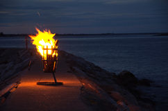 Bonfire at harbor Royalty Free Stock Image