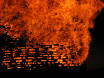 Bonfire IV. Close-up of wooden pallets burning in great bonfire with fire texture and details Royalty Free Stock Photos