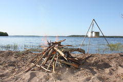 Bonfire and kettle on a tripod. Royalty Free Stock Images