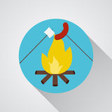 Bonfire with marshmallow and sausage- vector icon with shadow on a round blue button Stock Images