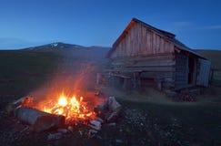 Bonfire near the house Stock Image