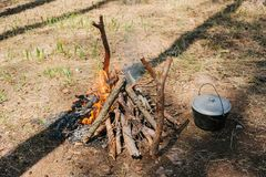 Bonfire next to the tourist camp. Journey into the wild concept. Royalty Free Stock Photo