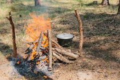 Bonfire next to the tourist camp. Journey into the wild concept. Royalty Free Stock Photography