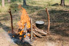 Bonfire next to the tourist camp. Journey into the wild concept. Royalty Free Stock Image