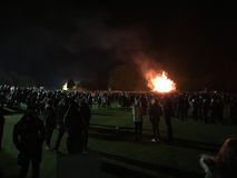 Bonfire night festivities of Lewes. Lewes, England - 5 November 2016: Crowd gathering around the great bonfire of the yearly celebration of the Bonfire night Royalty Free Stock Photography