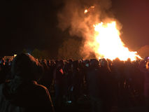 Bonfire night festivities of Lewes. Lewes, England - 5 November 2016: Crowd gathering around the great bonfire of the yearly celebration of the Bonfire night Royalty Free Stock Photo