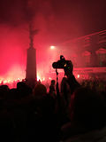 Bonfire night festivities of Lewes. Lewes, England - 5 November 2016: Dark and crowded streets of Lewes are covered in smoke due to the explosions and fire Stock Image