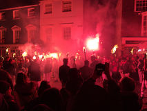 Bonfire night festivities of Lewes. Lewes, England - 5 November 2016: Dark and crowded streets of Lewes are covered in smoke due to the explosions and fire Royalty Free Stock Photo