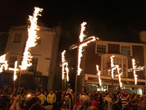 Bonfire night festivities of Lewes. Lewes, England - 5 November 2016: Dark and crowded streets of Lewes for the fire parade of the yearly celebration of the Royalty Free Stock Photos