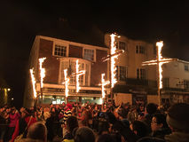 Bonfire night festivities of Lewes. Lewes, England - 5 November 2016: Dark and crowded streets of Lewes for the fire parade of the yearly celebration of the Royalty Free Stock Photography