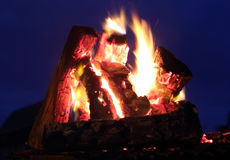 A bonfire over the dark blue sky extrim closeup Royalty Free Stock Images