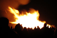 Bonfire party. Crowd of people observing a bonfire Stock Images