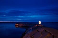 Bonfire at a pier Stock Images