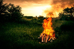 Bonfire scenery. Bonfire at a camp in natural surroundings Stock Photo