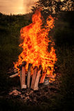 Bonfire scenery. Bonfire at a camp in natural surroundings Royalty Free Stock Photo