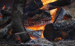 Bonfire with some metall blacksmith`s instruments Stock Photo