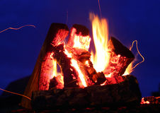 A bonfire and sparks over the dark blue sky extrim closeup Stock Photography