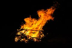 Bonfire in the tourist camp at night. Red flames on a black background. Forest fire stock photography