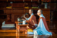 Bongeunsa Temple. Two Buddhist monks chant prayers at Bongeunsa Temple on October 12, 2014 in Seoul, South Korea Royalty Free Stock Images