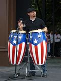 Bongo Drummer. Photo of bongo drummer at the cinco de mayo celebration on 5/2/10 at the washington monument grounds in washington dc. These two people are