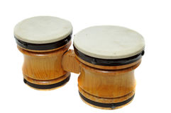 Bongo Drums. Two pair of miniature toy bongo drums isolated on white background stock photo