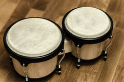 Bongo drums at home wooden surface Royalty Free Stock Photos