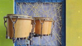 Bongos on the background colors  wall.  Royalty Free Stock Images