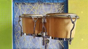 Bongos on the background colors  wall.  Stock Images