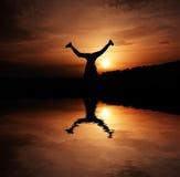 Bonheur au coucher du soleil Photo stock