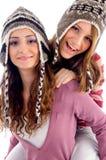 bonheur de filles affichant ensemble deux Photo stock