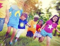 Bonheur de sourire d'unité d'amitié d'enfants Photographie stock libre de droits