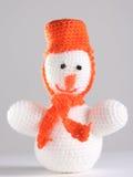 Bonhomme de neige blanc au fond gris Photo stock