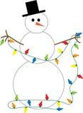 Bonhomme de neige décorant des lumières Image libre de droits