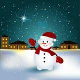 Bonhomme de neige dans le village Image libre de droits