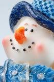 Bonhomme de neige de Noël sur le fond blanc Photographie stock libre de droits