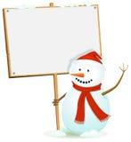 Bonhomme de neige de Santa retenant le signe en bois Photos stock