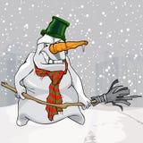 Bonhomme de neige effrayant mauvais de bande dessinée avec le balai dans des mains Photo stock