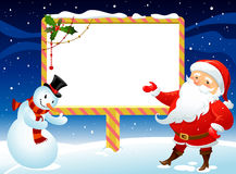 Bonhomme de neige et père noël Photographie stock libre de droits