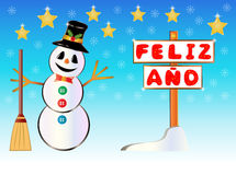 Bonhomme de neige jugeant un poteau indicateur heureux d'année écrit sur l'Espagnol Photos libres de droits