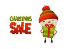 Bonhomme de neige mignon heureux de bande dessinée avec le présent de cadeau et la vente de Noël des textes image stock
